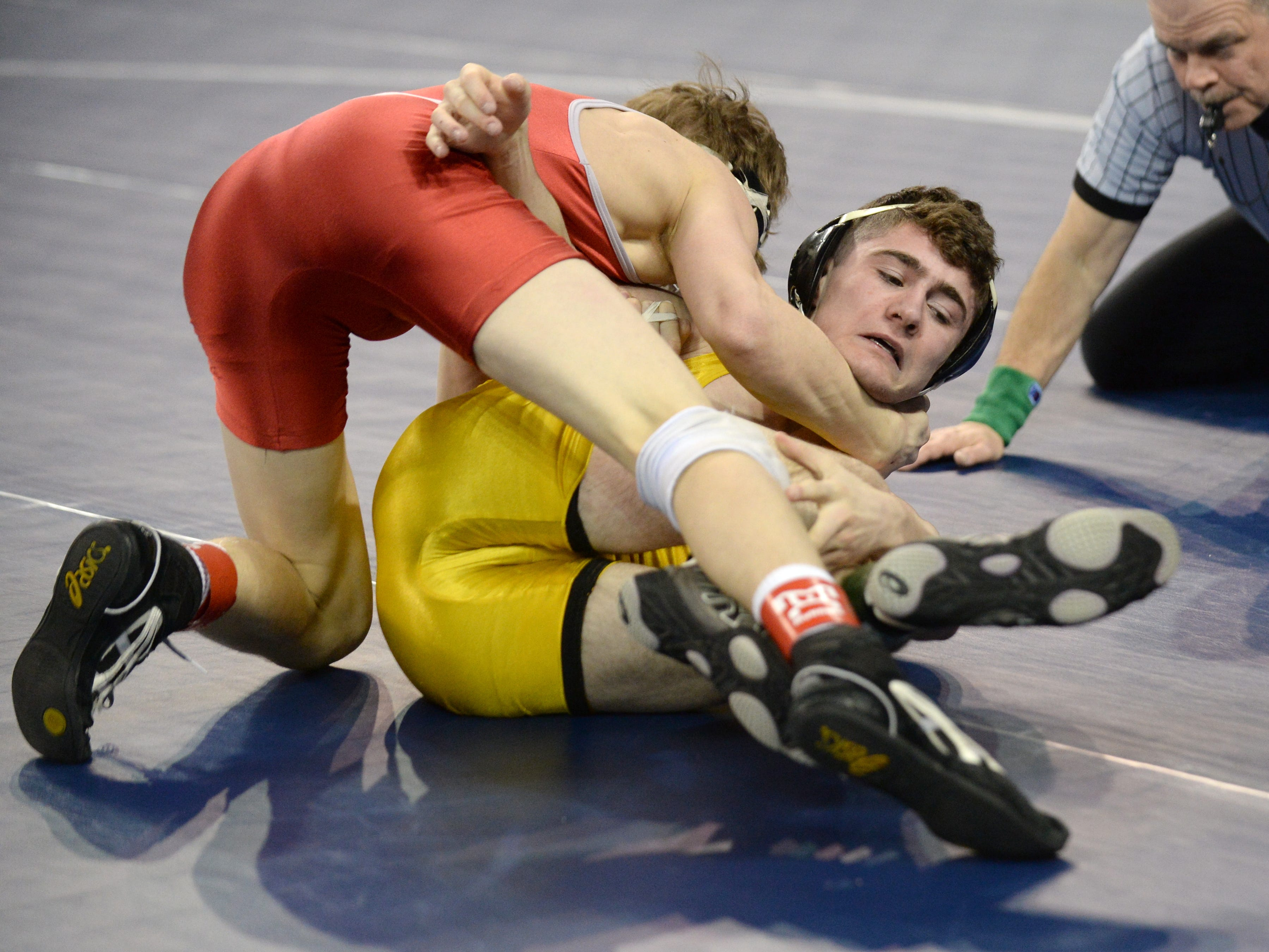 North Hunterdon's Connor Robinson attempts to get away from a pin High Point's Devin Flannery in a 120-pound first round bout during the NJSIAA Individual Wrestling Championships at Boardwalk Hall in Atlantic City, Thursday, Feb. 28, 2019.