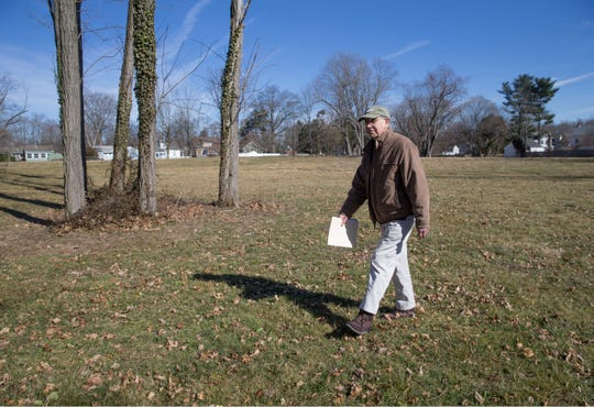 John Fabiano, director of the Monmouth County Historical Commission, walks along the tract of open space that will become Ashby Park in Allentown.