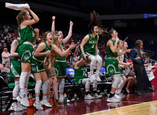 The Wall Lady Hawks cheer their teammates during Thursday's UIL Class 3A girls state basketball semifinal against Mount Pleasant Chapel Hill, held at the Alamodome in San Antonio Feb. 28, 2019.
