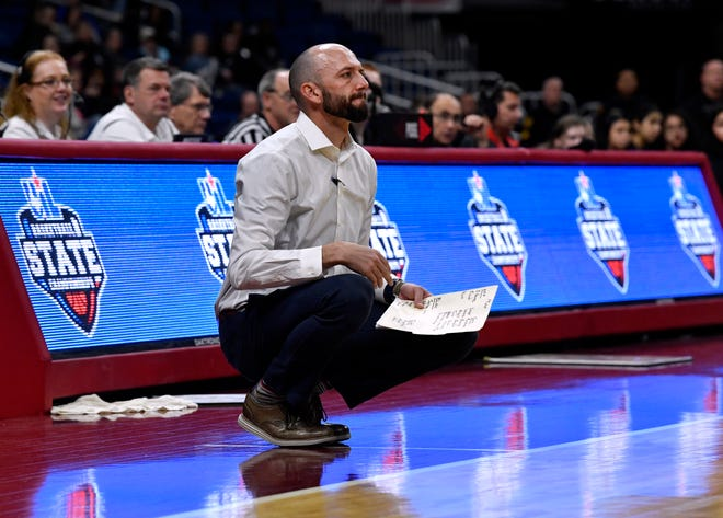 Wall head coach Tate Lombard watches his Lady Hawks play during Thursday's UIL Class 3A girls state basketball semifinal against Mount Pleasant Chapel Hill at the Alamodome in San Antonio Feb. 28, 2019.