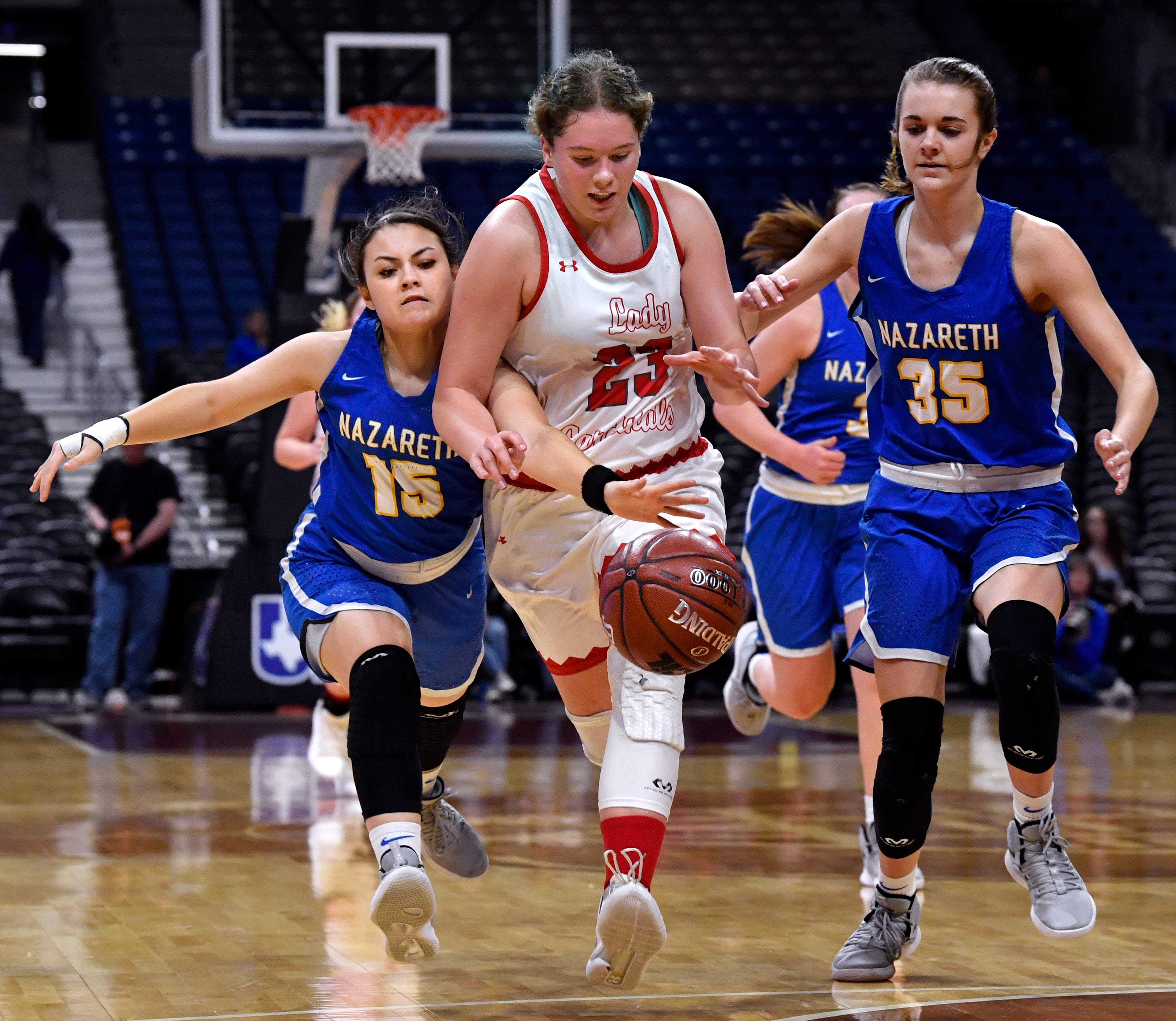 Nazareth guard Lexis Nieves tries to steal the ball from Hermleigh forward Makia Gonzales during Thursday's UIL Class 1A girls state basketball semifinal at the Alamodome in San Antonio Feb. 28, 2019.