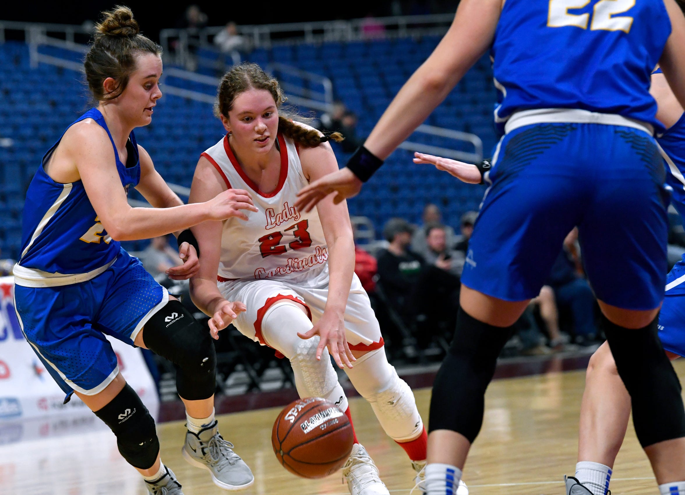 Hermleigh's Makia Gonzales drives to the basket past Nazareth forward Hallie Kleman during the Class 1A girls state basketball semifinal. The Lady Cardinals have made the state tournament in both years under former Wylie and Hardin-Simmons player Duane Hopper
