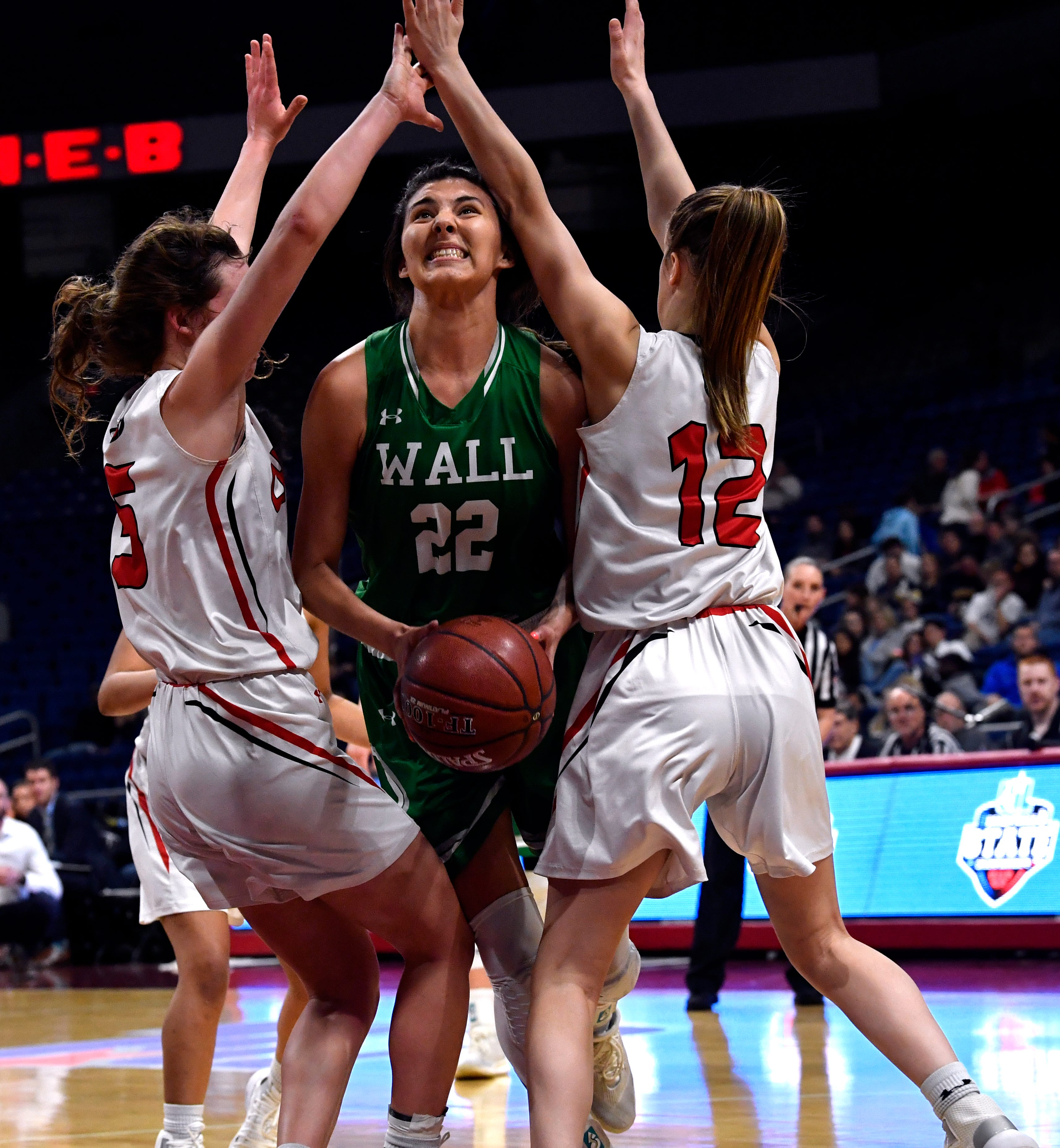 Wall forward Samantha Rocha is squeezed between Rebekah Crane (left) and Kinly Posey during the Lady Hawks' Thursday UIL Class 3A girls state basketball semifinal against Mount Pleasant Chapel Hill at the Alamodome in San Antonio Feb. 28, 2019.