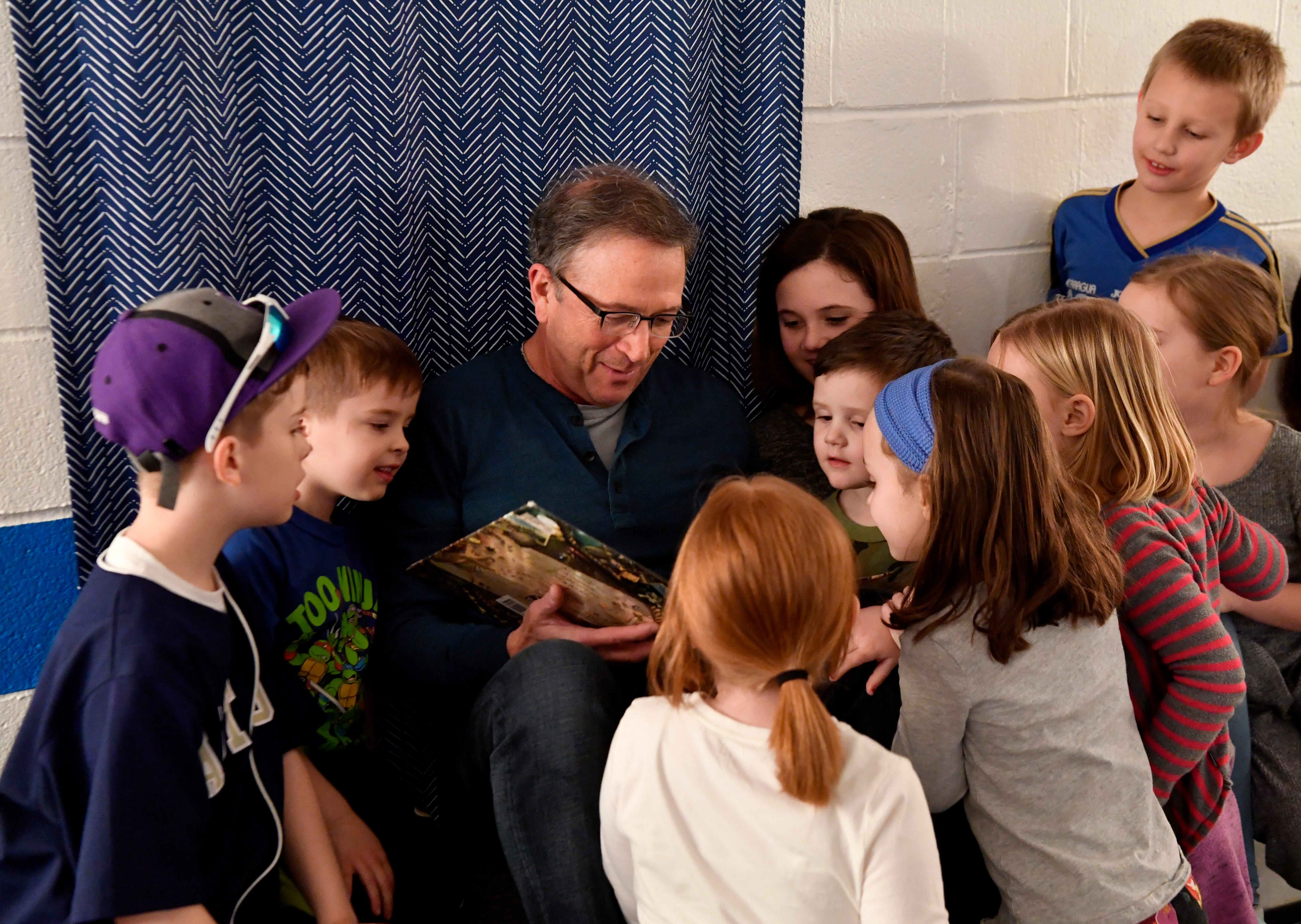 Mike Cope is surrounded by children at Highland Church of Christ. He was lead minister there from 1991 to 2009.