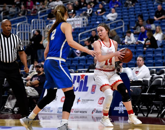 Hermleigh guard Ciera Digby looks for an opening past Nazareth guard Blakely Gerber during Thursday's UIL Class 1A girls state basketball semifinal at the Alamodome in San Antonio Feb. 28, 2019.