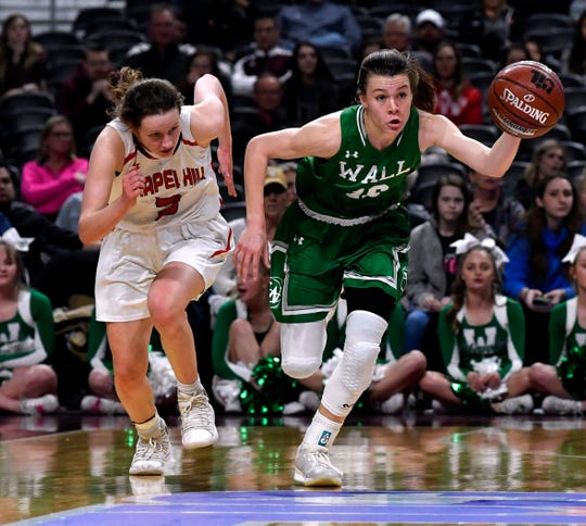 Wall guard Sawyer Lloyd sprints away from Mount Pleasant Chapel Hill guard Rebekah Crane during Thursday's UIL Class 3A girls state basketball semifinal at the Alamodome in San Antonio Feb. 28, 2019.