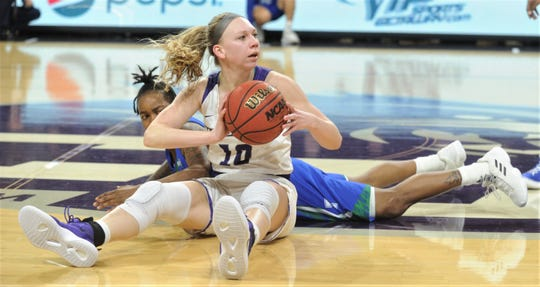ACU's Breanna Wright passes the ball after beating a a Texas A&M-Corpus Christi player for a loose ball. ACU beat the Islanders 72-55 in the Southland Conference game Wednesday, Feb. 27, 2019, at Moody Coliseum.