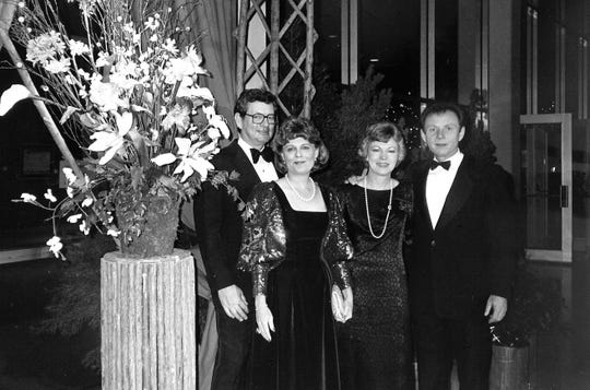 From left, Ruth and Lee Caldwell pose with the Jim Alexanders at a Cotillion presentation ball in November 1984.