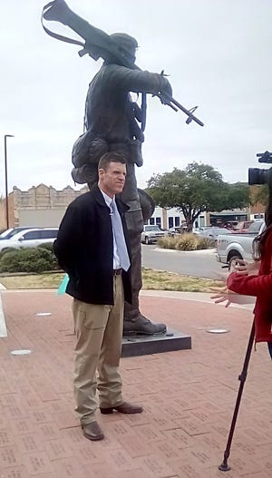 John Meier,  West Central Texas Regional Foundation's Supportive Services for Veteran Families Program Manager, addresses media at the Taylor County Courthouse at a news conference Thursday about successful efforts to end veteran homelessness in Abilene.