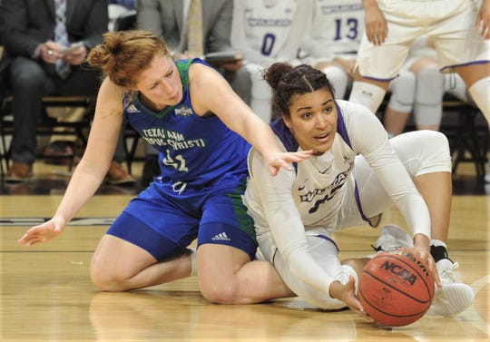 ACU's Makayla Mabry, right, battles Texas A&M-Corpus Christi's Emma Young for a loose ball. ACU beat the Islanders 72-55 in the Southland Conference game Wednesday, Feb. 27, 2019, at Moody Coliseum.