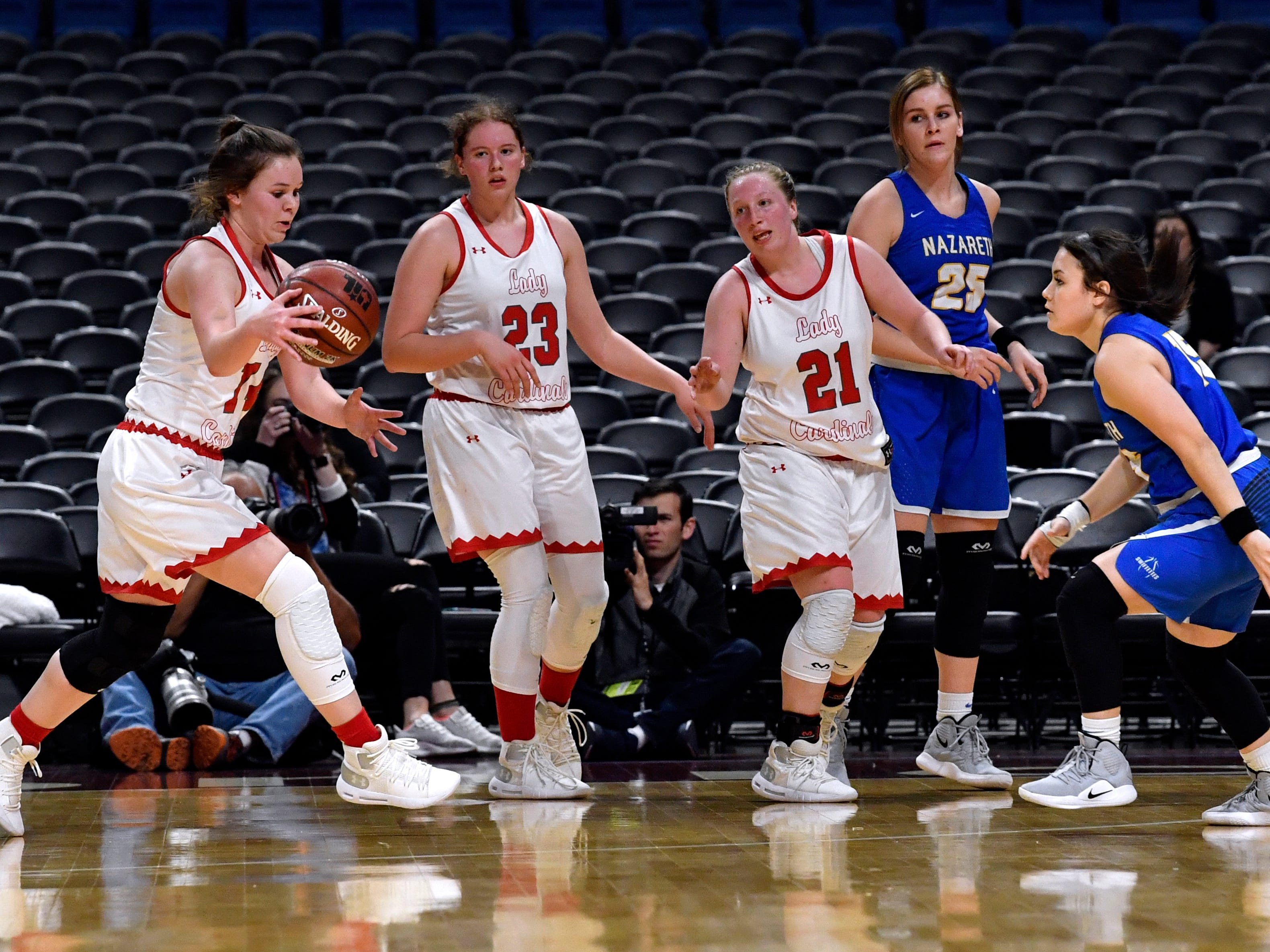 Hermleigh players Ciera Digby (left), Makia Gonzales, and Lillian Digby gain control of the ball against Nazareth during Thursday's UIL Class 1A girls state basketball semifinal at the Alamodome in San Antonio Feb. 28, 2019.