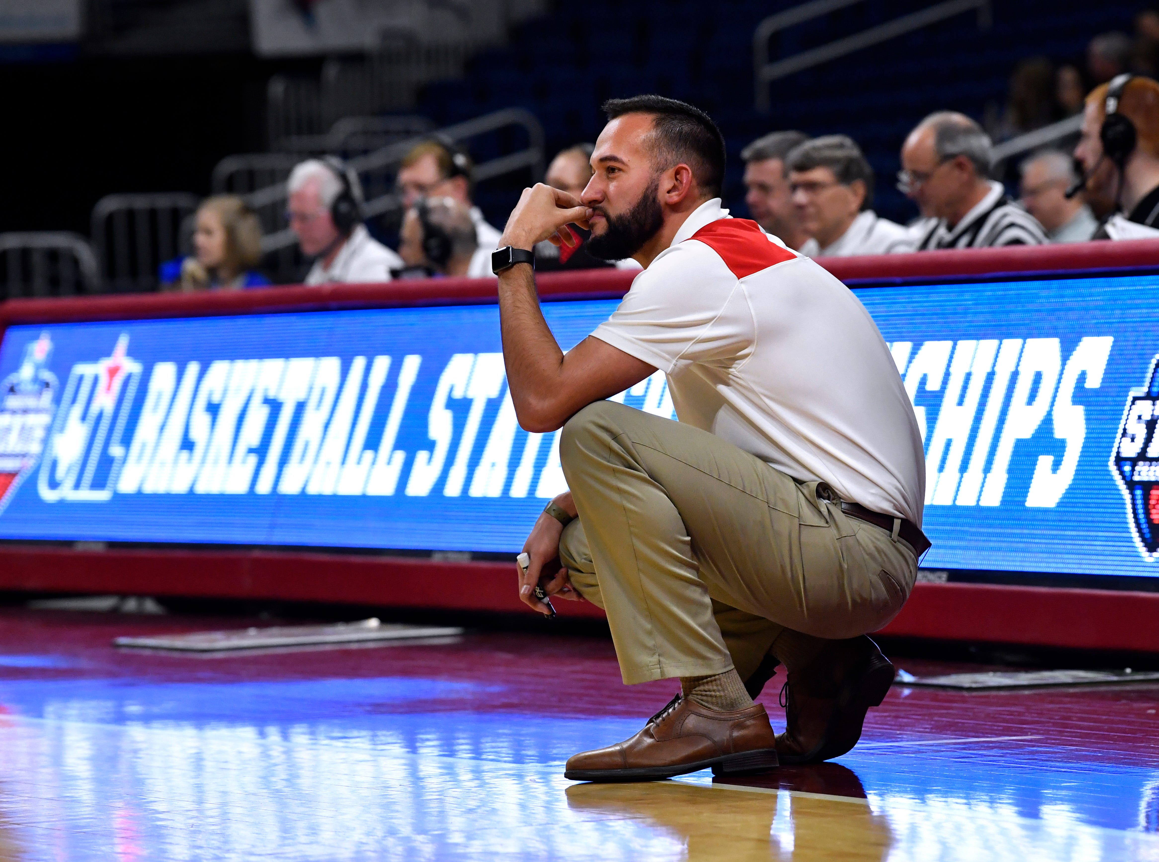 Hermleigh Lady Cardinals head coach Duane Hopper watches the last plays of Thursday's UIL Class 1A girls state basketball semifinal at the Alamodome in San Antonio Feb. 28, 2019.