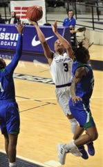 ACU's Dominique Golightly (3) drives to the basket against the Texas A&M-Corpus Christi defense. Golightly scored a game-high 17 points in the Wildcats' 72-55 victory over the Islanders on Wednesday at Moody Coliseum.