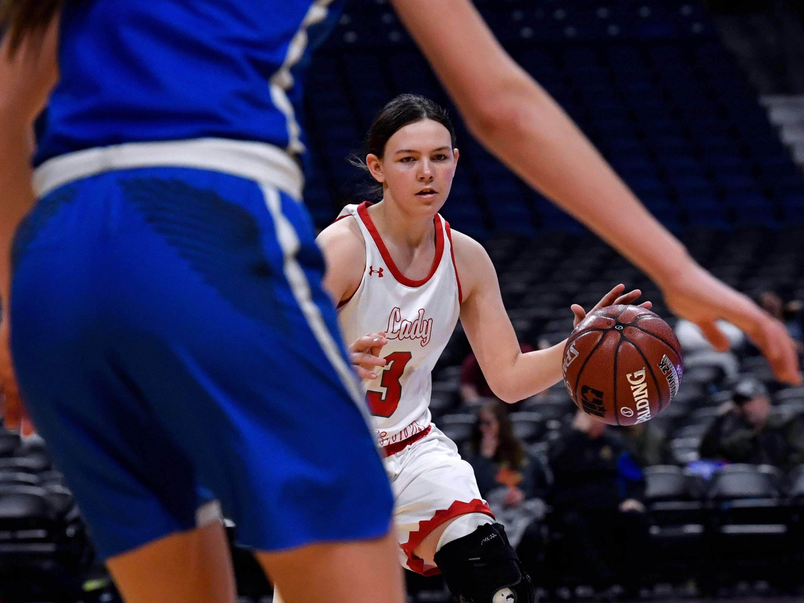 Hermleigh guard Brittany Smith approaches the basket and Nazareth guard Blakely Gerber during Thursday's UIL Class 1A girls state basketball semifinal at the Alamodome in San Antonio Feb. 28, 2019.