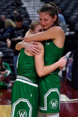 Wall's Payton Box (left) and Jayden Fiebiger comfort each other after their team's loss in Thursday's UIL Class 3A girls state basketball semifinal against Mount Pleasant Chapel Hill, held at the Alamodome in San Antonio Feb. 28, 2019.