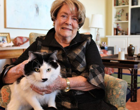 Molly Cline and her cat Patches, who made the photographer purrfectly welcome in her home.