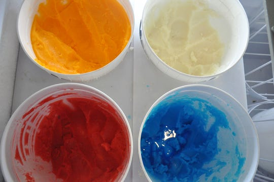 2 Profs Gourmet Ice cream offers non-dairy Italian ice in several colorful flavors, including orange cream and strawberry.