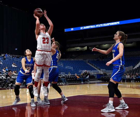 Hermleigh junior forward Makia Gonzales shoots during Thursday's UIL Class 1A girls state basketball semifinal against Nazareth at the Alamodome in San Antonio Feb. 28, 2019.