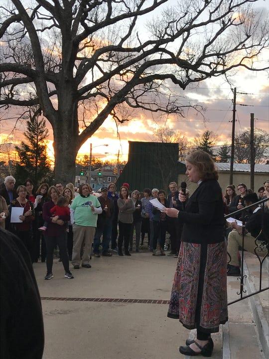 Reverend Nancy Dixon Walton of Trinity United Methodist Church speaks at a candlelight vigil Wednesday night.
