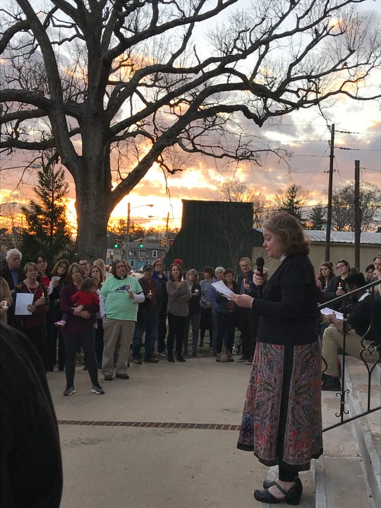 Reverend Nancy Dixon Walton of Trinity United Methodist Church speaks at a candlelight vigil Wednesday night.