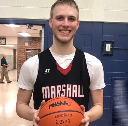 Marshall's Jeremy Luciani showing off the ball that he scored his 1,000 career point with.