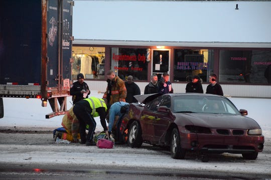 Rescue workers at the scene of Wednesday's crash.