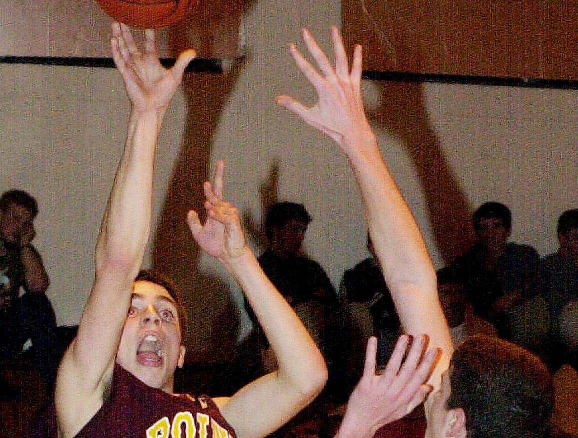 2001: Whitney Point's Adam Moss, left, takes a shot during the first half as he is guarded by Maine-Endwell's Kyle Grahame, right, Wed night.