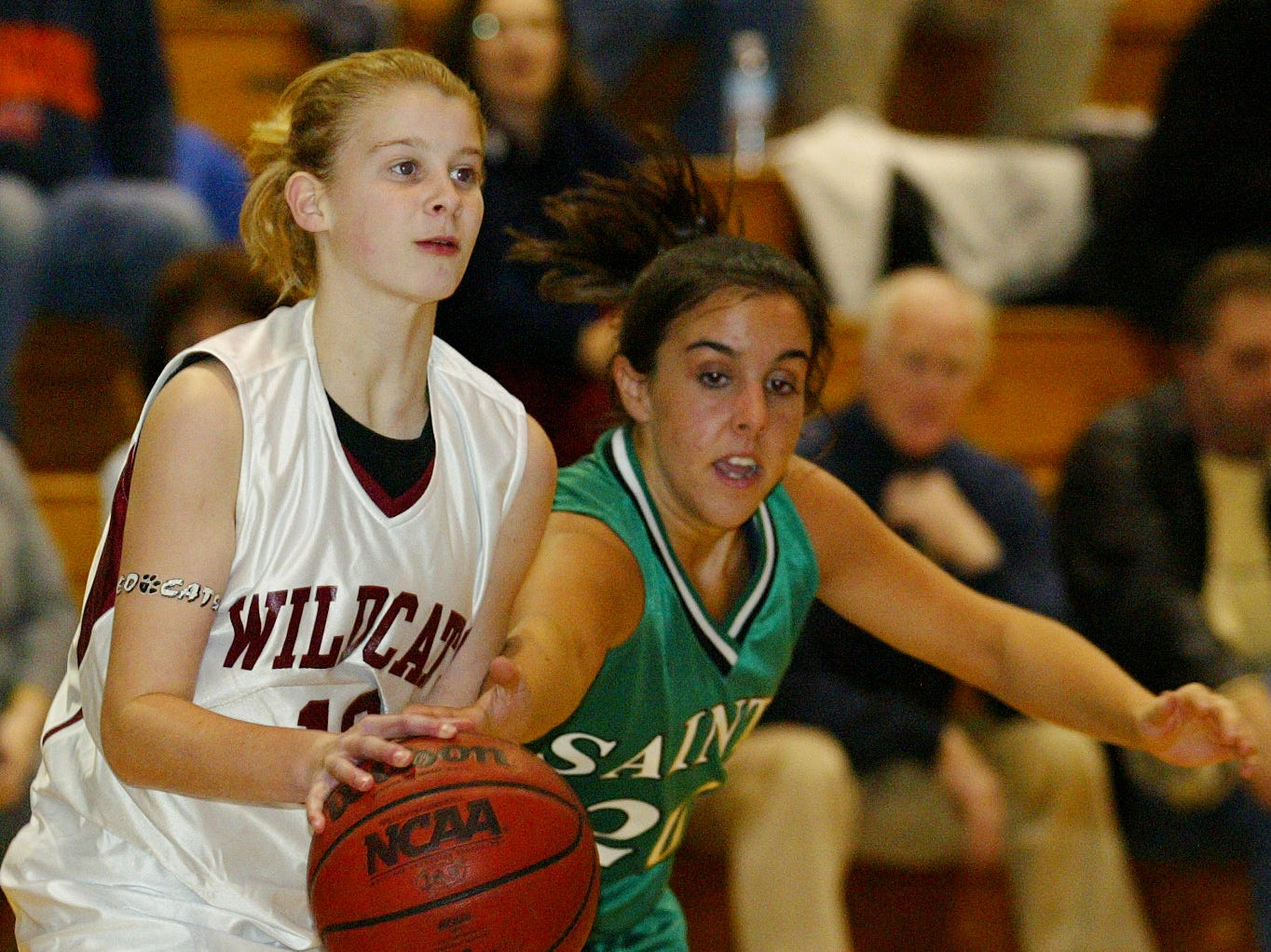 2005: Johnson City's Emily McSain loses control of the basketball as Seton Catholic Central's Kristen Yesensky makes the move in the second period, Wednesday at Johnson City High School.