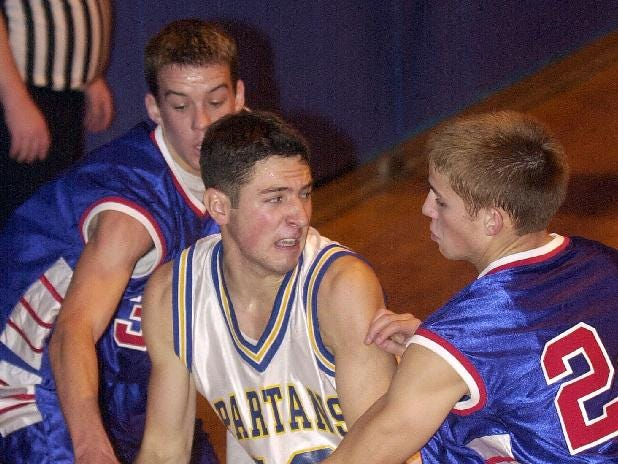 2001: Maine-Endwell's Tony Maione, center, near the baseline as Owego Free Academy defenders, Paul Dotman, left, and Jesse Skellett, right, try to steal the ball during the third quarter of Wed's game.