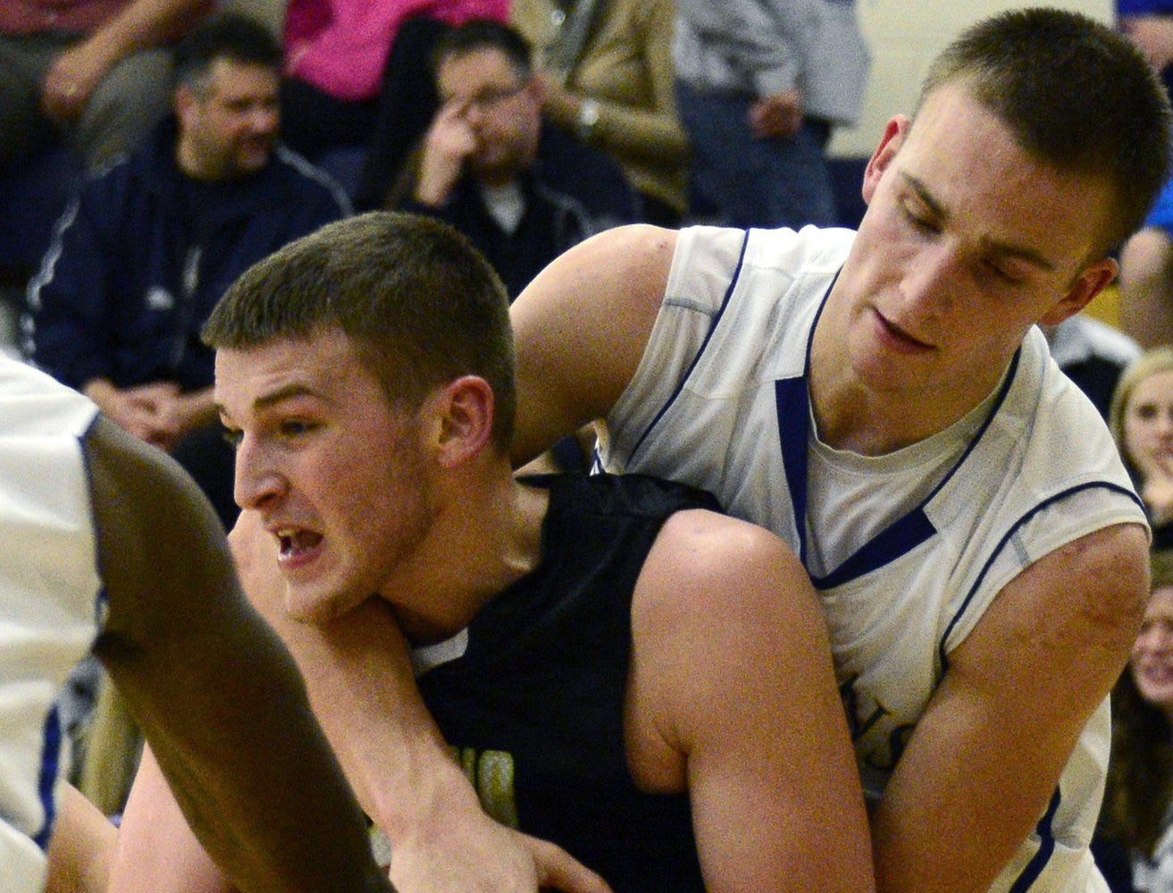 2012: Kyle Gallagher of Maine-Endwell tries to grab the ball from Corning's Jared Cramer in Tuesday's 73-43 Spartans victory at Maine-Endwell High School.