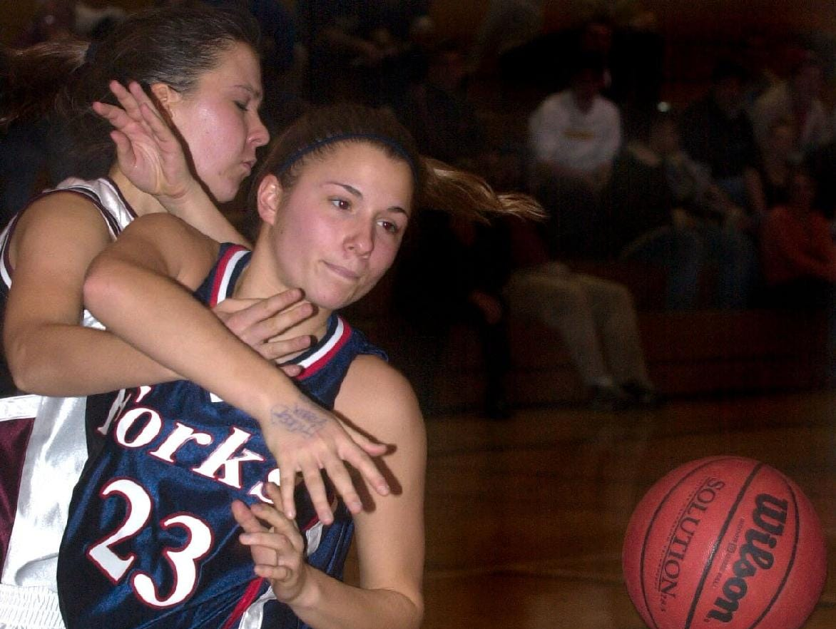 2001: Chenango Forks' Gina Juriga finds herself all wrapped up with Johnson City's Cynthia Bors while battling for a loose ball during Wednesday night's game at JC.  Chenago Forks won, 63-54.