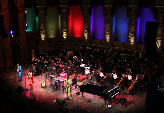 The Classical Mystery Tour travels around the county to perform Beatles music with orchestras. Here, they are pictures with the Vancouver Symphony Orchestra.