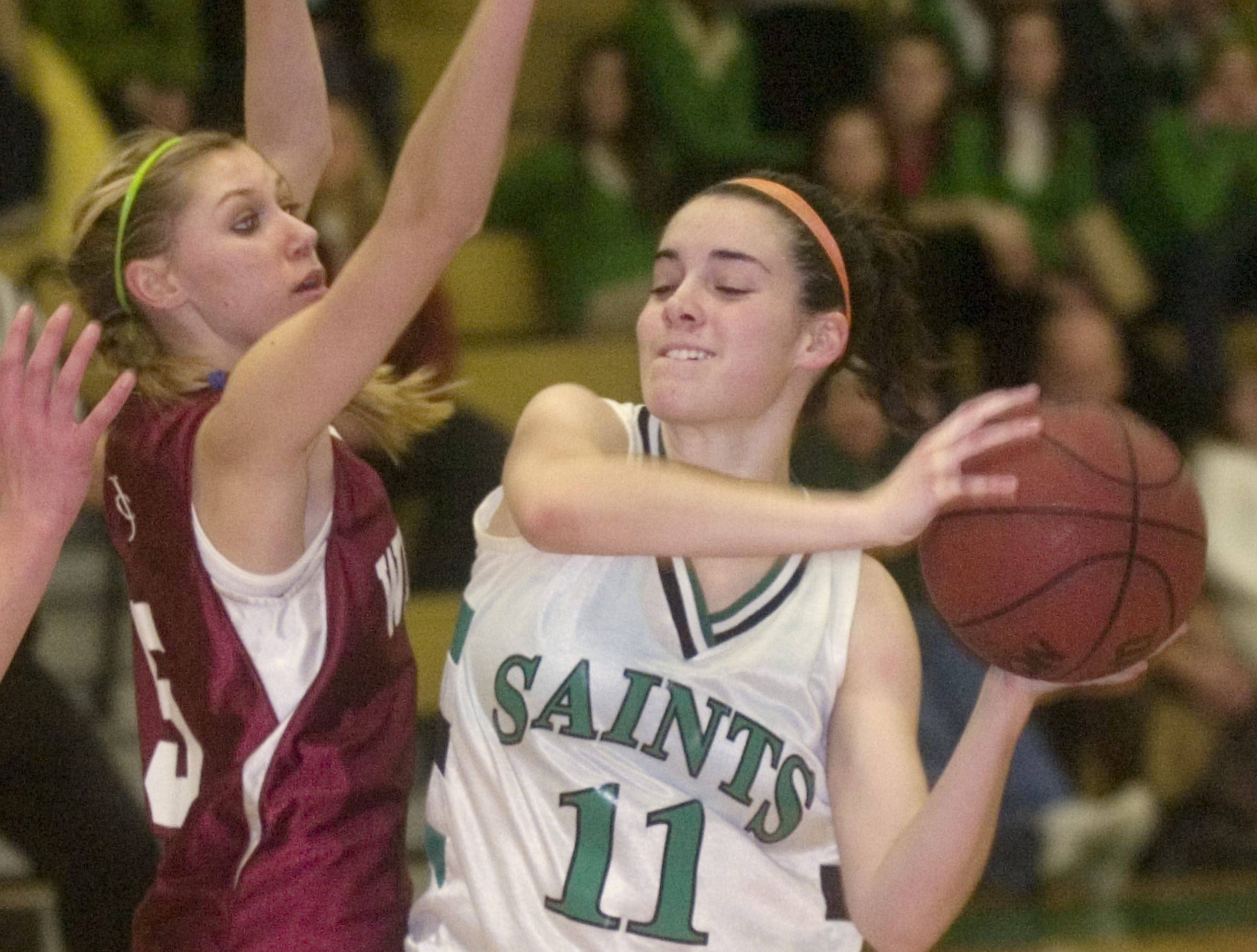 2009: Seton Catholic Central's Sarah Canny, right, is defended by Johnson City's Amanda Dustin in the first quarter of Wednesday's game at Seton.