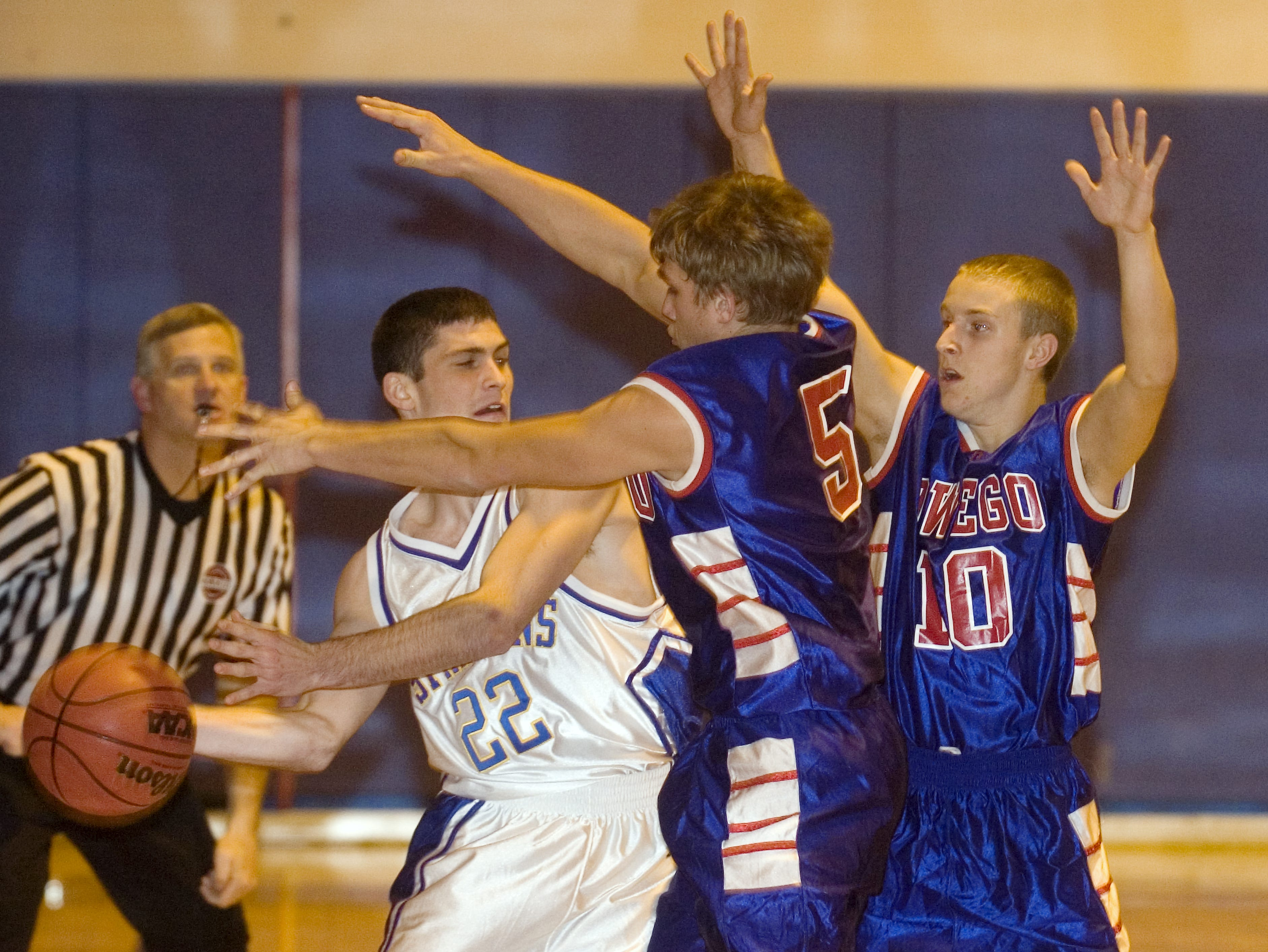 2008: Owego Free Academy's Kevin Kie, right, and Harley Edwards double team Maine-Endwell's Joe Powell in the first quarter of Wednesday's game at M-E.