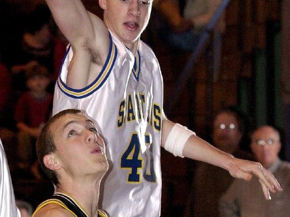 Windsor's Dan Nichols, left, looks toward the basket as he is guarded by Maine-Endwell's Kyle Grahame, back right, during a game the Black Knights won at the buzzer on Dec. 22, 2001.