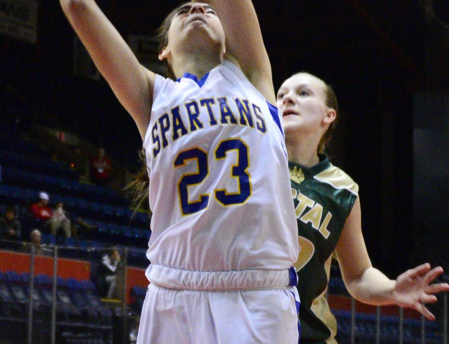 2013: Maine-Endwell's Carla Spera shoots in front of Vestal's Jen Shelp in the Section 4 Class A championship game Friday night at the Broome County Veterans Memorial Arena. The Spartans claimed the title with a 58-49 victory.