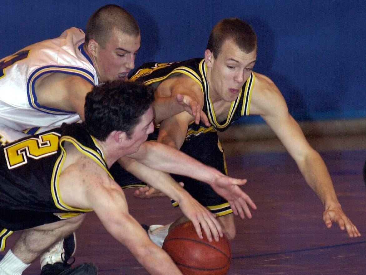 2001: Windsor's Joe Costello, left, Maine-Endwell's Rob Krowiak, center back, and Windsor's Dan Nichols, right, lunge for a loose ball during the second half of Sat's Black Knight victory.