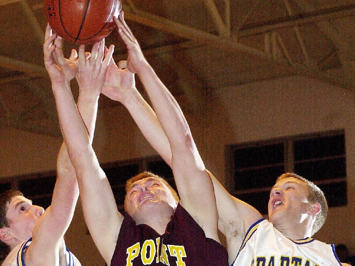 2001: Maine-Endwell's Kyle Grahame, left, Whitney Point's Michael Miller, center, and Maine-Endwell's Andy Travis, right, battle for a rebound during the fourth quarter of Wed's 64-56 Spartan win.