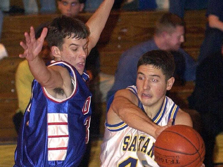 2001: Maine-Endwell's Tony Maione, right, passes the ball around Owego Free Academy's Pat Dotman, left, at the top of the key during the third quarter of Wed's game.