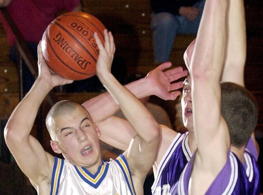 2001: Maine-Endwell's Rob Krowiak, left, is elbowed as he is guarded by Dryden's Jeff Lang, center, and Nate Thoma, right, during the fourth quarter of Tues's Spartan 79-73 loss.
