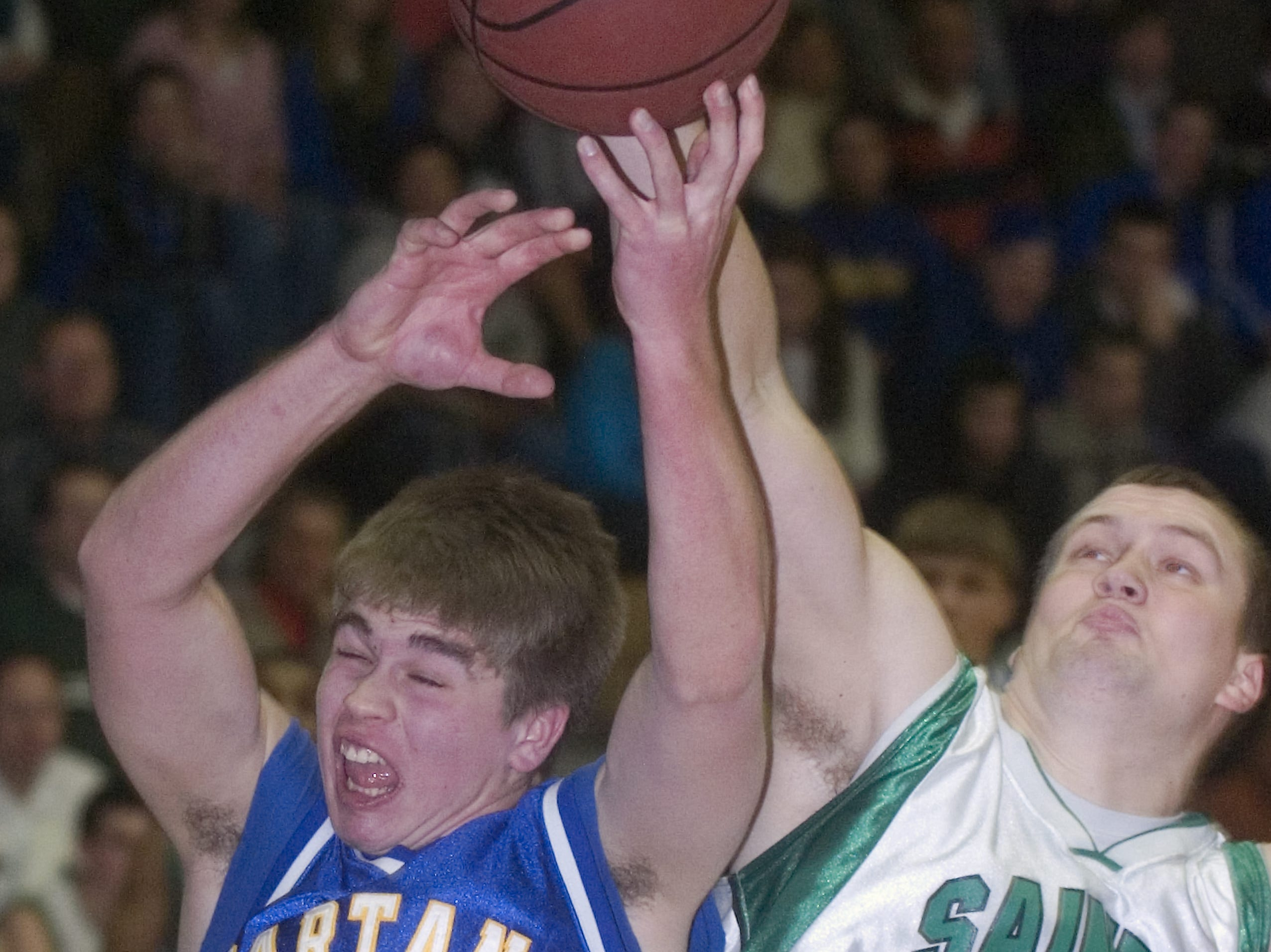 2009: Seton Catholic Central's Chris Furner, right, blocks a shot by Maine-Endwell's Brian Ruby in the second quarter of Saturday's game at Seton.