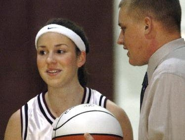 2005: Johnson City varsity basketball coach, Fred Deinhardt, presents Colleen Clarke with a commemorative basketball after scoring her 1000th point in the first period of the Tuesday night basketball game against Maine-Endwell.