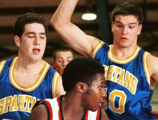 1998: Binghamton High School's Tremayne Jackson, middle, looks for the outlet pass to a teammate around the defense put up by Maine-Endwell's Joshua Sussman, left, and John Frieser, right, during the first half of Tuesday evening's game at Binghamton High School.