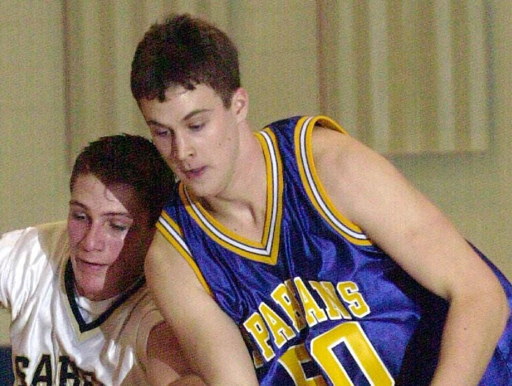 2001: Susquehanna Valley's Patrick Whalen, left, gets tangled up with M-E's Dan Powell, right, as they both go for a loose ball. Powell picked up two points on a lay-up on the play in the second half of Sat night's Spartan win.
