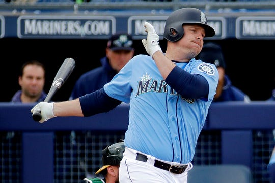 Seattle Mariners' Jay Bruce bats during the third inning of a spring training baseball game against the Oakland Athletics Friday, Feb. 22, 2019, in Peoria, Ariz. (AP Photo/Charlie Riedel)