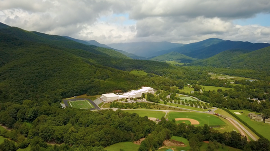 An aerial view of Owen High School captures the surrounding beauty of the Swannanoa Valley.