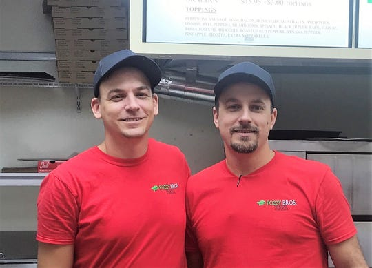 Jordan, left, and Adam Pozdoll have opened Pozzy Bros. Pizza with their brother Justin.