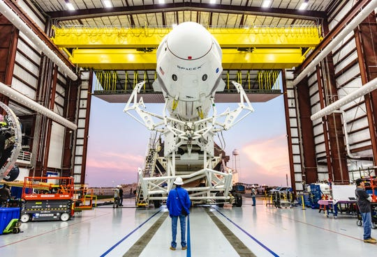 SpaceX's Falcon 9 rocket and Crew Dragon roll out to Kennedy Space Center's pad 39A.
