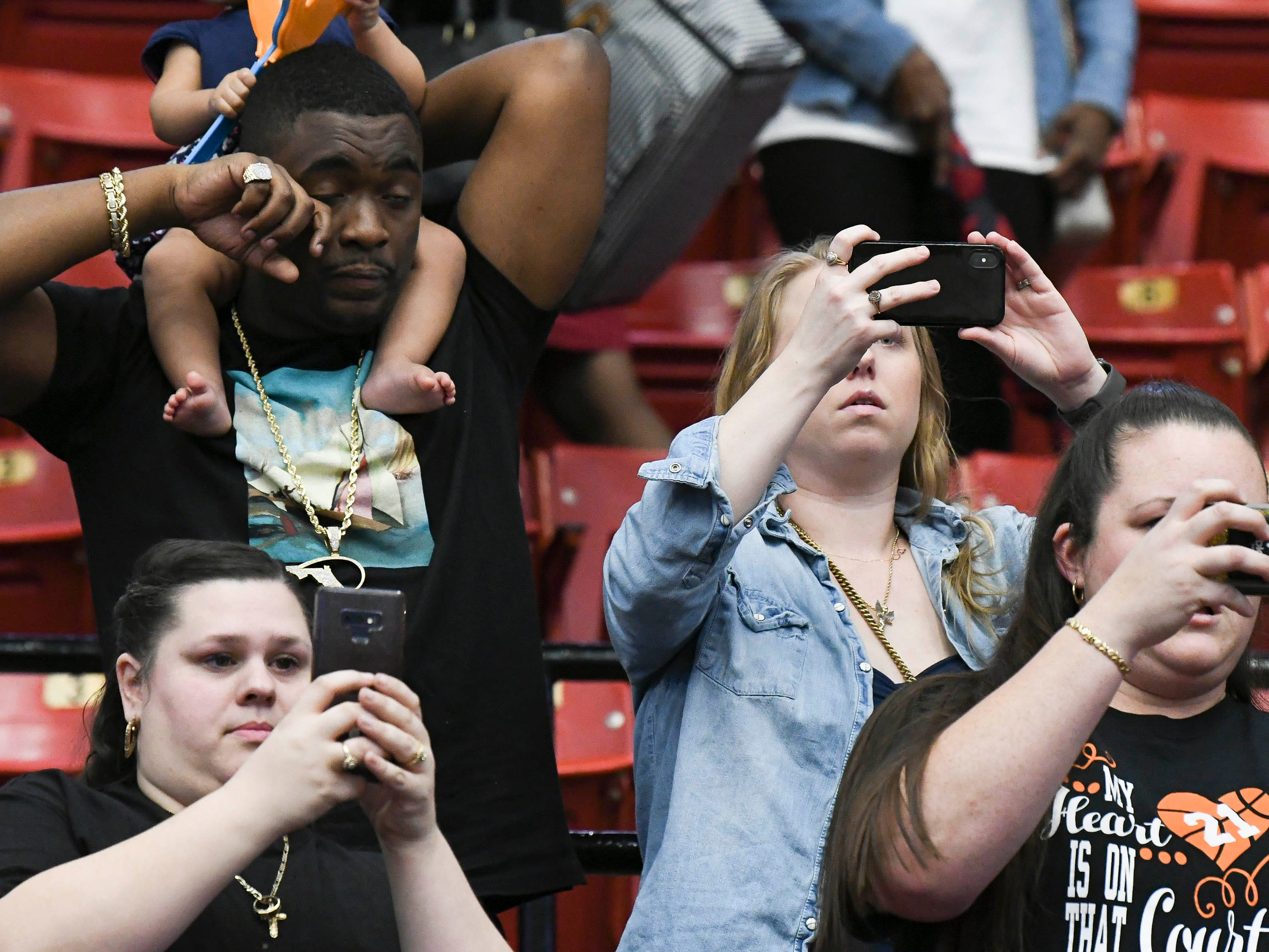 Florida Prep fans cheer for the Lady Falcons and take photos during Tuesday's Class 2A state championship game.
