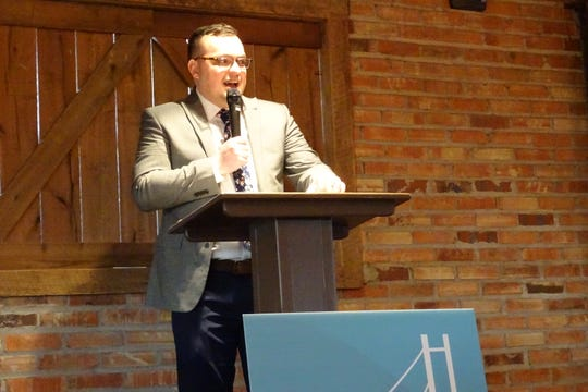 Tyler Jacobs, executive director of the Bucyrus Area Chamber of Commerce, welcomes business leaders to the Business and Industry Forecast Breakfast at Pickwick Place earlier this year. On Thursday, Chamber members will return to Pickwick for the Route 30 Business Expo.